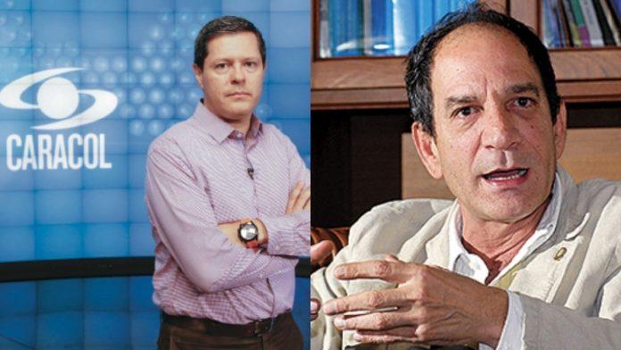 Juan Carlos Henao frente al director de Noticias Caracol Juan Roberto Vargas