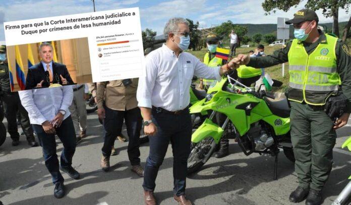 Colombianos firman para que justicia internacional condene a Iván Duque