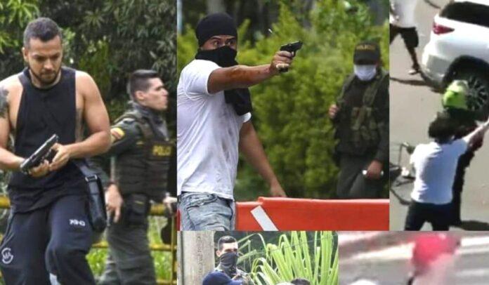 Civiles disparando contra manifestantes en Colombia